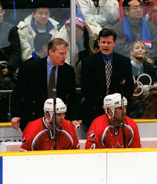 Canada's Wayne Cashman (L) and Marc Crawford, coaches for the Canadian Men's Hockey Team, at the 1998 Nagano Winter Olympics. (CP PHOTO/COA)