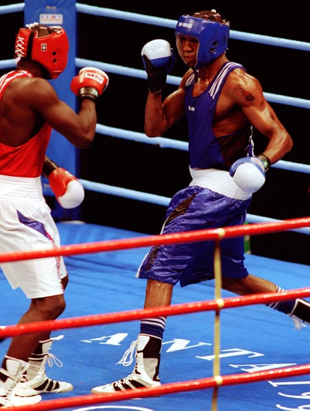 Canada's David Defiagborn (blue) in action boxing against his opponent at the 1996 Atlanta Summer Olympic Games. (CP PHOTO/COA/Scott Grant)