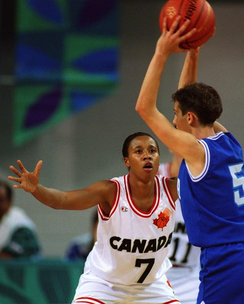 Canada's Sue Stewart (white jersey) playing women's basketball at the 1996 Atlanta Summer Olympic Games. (CP PHOTO/COA/Scott Grant)