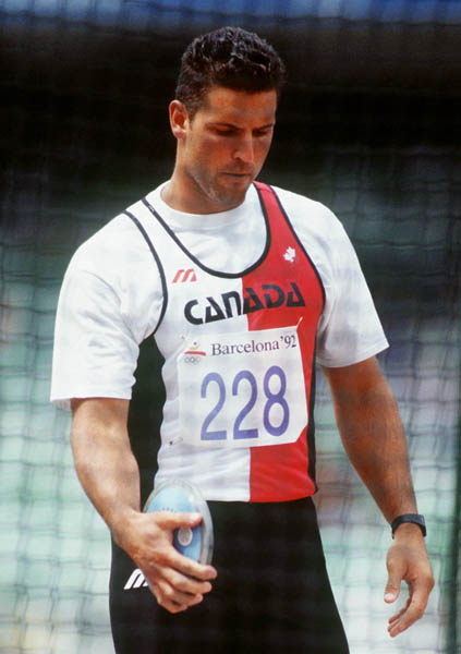 Canada's Ray Lazdins competing in the discus event at the 1992 Olympic games in Barcelona. (CP PHOTO/ COA/ Claus Andersen)