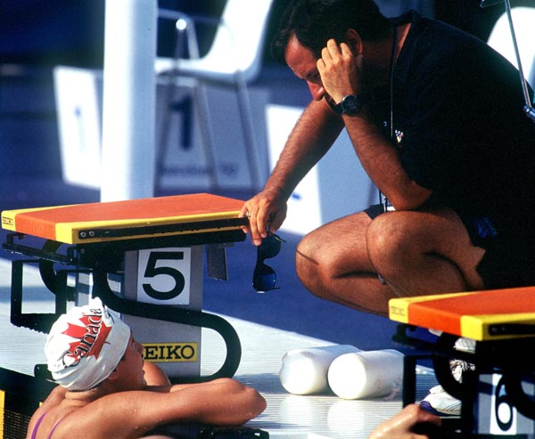 Canada's Marianne Limpert and swimming coach Byron MacDonald at the 1992 Olympic games in Barcelona. (CP PHOTO/ COA/Ted Grant)