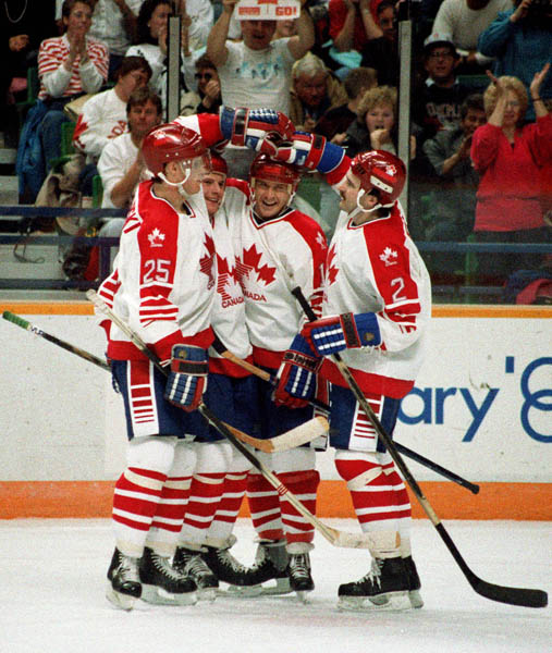 Canada's men's hockey team celebrate during  hockey action at the 1988 Winter Olympics in Calgary. (CP PHOTO/ COA/ S.Grant)