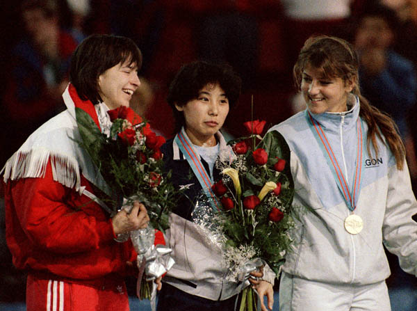Canada's Sylvie Daigle (left) celebrates her silver medal win in the speedskating event with gold medal winner Yan Li (centre) of China and bronze medal winner Monique Velzeboer (right) of the Netherlands at the 1988 Winter Olympics in Calgary. (CP PHOTO/