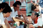 Canada's Trevor Clarke coaching the men's field hockey team discusses strategy at the 1988 Seoul Olympic Games. (CP Photo/ COA/ T. Grant)