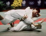 Canada's Nicolas Gill (left) competes in the judo event of the 2000 Sydney Olympic Games. (CP Photo/ COA)