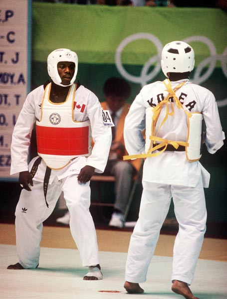 Canada's Albert Smythe (left) competes in the taekwondo event at the 1988 Seoul Olympic Games. (CP PHOTO/COA/ T. Grant)