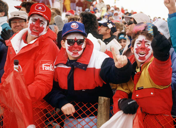 Canadian fans cheer in the crowd at the 1988 Winter Olympics in Calgary. (CP PHOTO/COA/ T. O'lett)