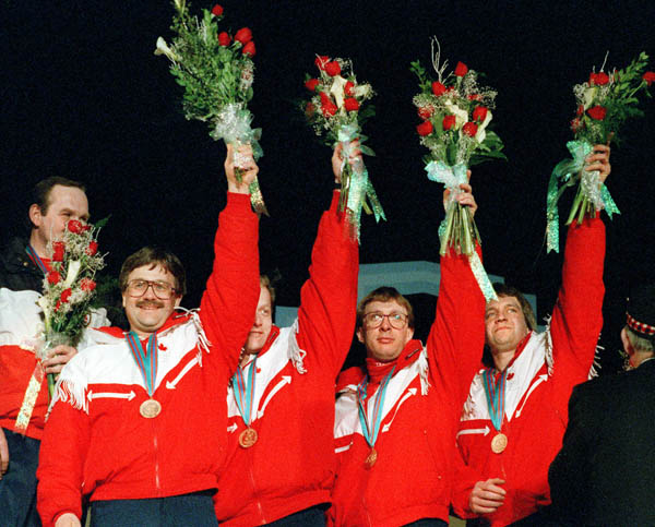(From left to right) Canada's Edward Lukowich, John Ferguson, Neil Houston and Brent Syme celebrate their bronze medal win in the men's curling event at the 1988 Calgary Olympic winter Games. (CP PHOTO/COA/Ted Grant)