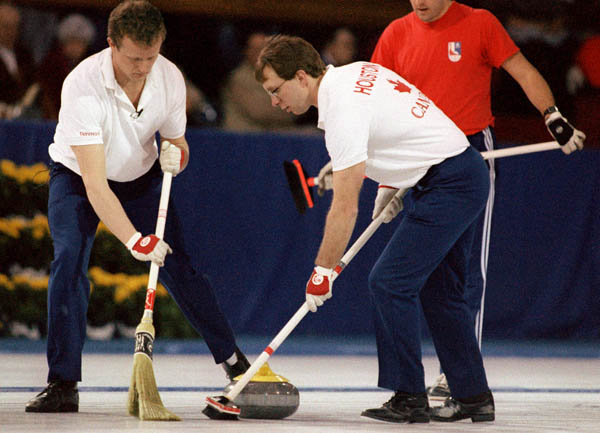 Canada's John Ferguson (left) and Neil Houston compete in the curling event at the 1988 Calgary Olympic winter Games. (CP PHOTO/COA/Ted Grant)