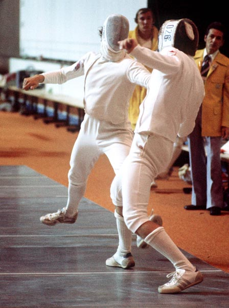 Canada's Marc Lavoie (right) competes in the fencing event at the 1976 Olympic games in Montreal. (CP PHOTO/ COA/ BB)