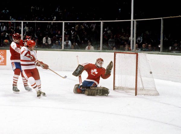 Canada's Mario Gosselin looks at the puck in the net as teammate Pat Flatley (left) fails to stop the opponent during hockey action against the USSR at the 1984 Winter Olympics in Sarajevo. (CP PHOTO/ COA/O. Bierwagon )