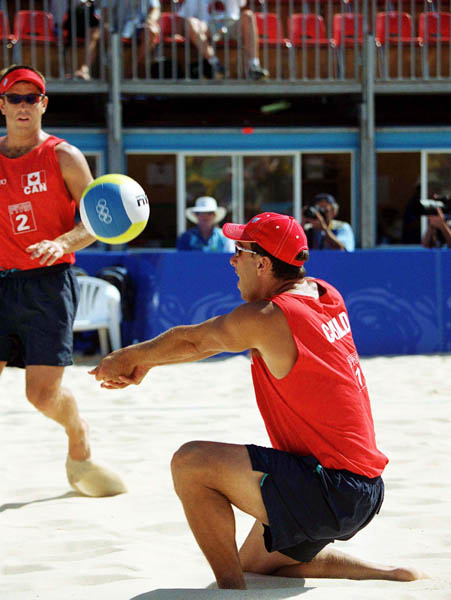 Canada's Mark Heese (left) and John Child play a set of beach volleyball at the 2000 Sydney Olympic Games. (CP Photo/ COA)