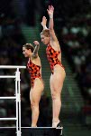 Canada's diving team, Emilie Heymans and Anne Montminy (left) , celebrates their silver medal win in the synchronized diving event at the 2000 Sydney Olympic games. (CP PHOTO/ COA)