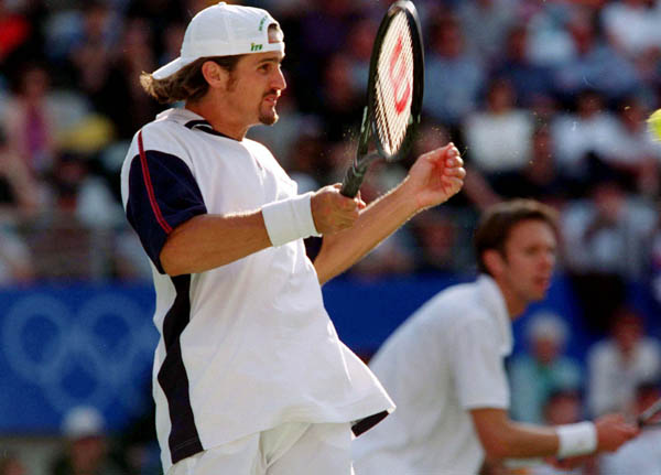Canada's Sebastian Lareau (foreground) and Daniel Nestor compete in tennis doubles at the 2000 Sydney Olympic Games. ( Mike Ridewood/CP Photo/ COA)