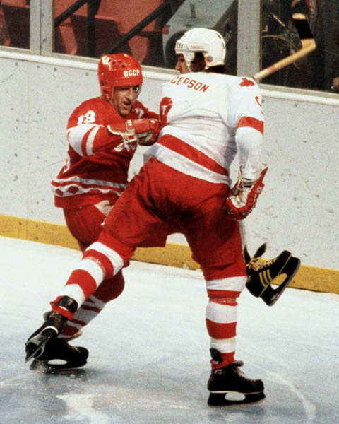 Canada's Warren Anderson (right) competes in hockey action against the U.S.S.R. at the 1980 Winter Olympics in Lake Placid. (CP Photo/ COA)