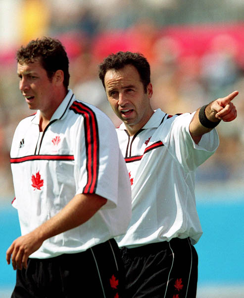 Canada's Scott Mosher (left) and Peter Milkovich exchange words during field hockey action at the 2000 Sydney Olympic Games. (CP Photo/ COA)