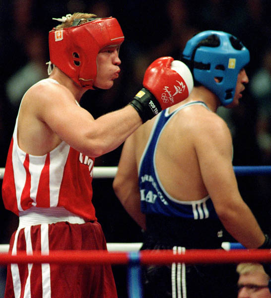 Canada's Mark Simmons (left) competes in the boxing event of the 2000 Sydney Olympic Games. (CP Photo/ COA)