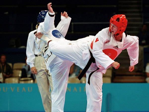 Canada's Dominique Bosshart (right) competes in the Taekwondo event of the 2000 Sydney Olympic Games. (CP PHOTO/ COA)