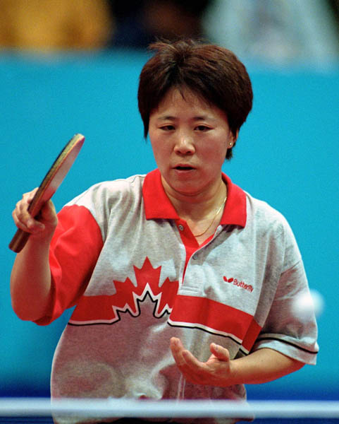 Canada's Lijuan Geng plays table tennis at the 2000 Sydney Olympic Games. (CP PHOTO/ COA)