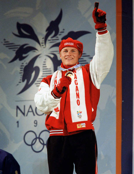 Canada's Ross Rebagliati celebrates after winning the gold medal in the snowboard event at the 1998 Nagano Olympic Games. (CP Photo/ COA)