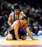 Canada's Oleg Ladik (blue) competes in the wrestling event at the 1996 Atlanta Olympic Games. (CP Photo/COA/Mike Ridewood)