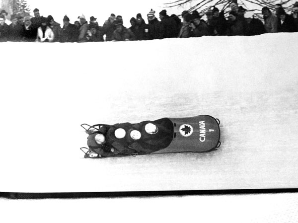 Canada's bobsleigh team, composed of Doug Anakin, Vic Emery, John Emery and Peter Kirby, compete in a gold medal performance at the 1964 Innsbruck winter Olympics. (CP Photo/COA)