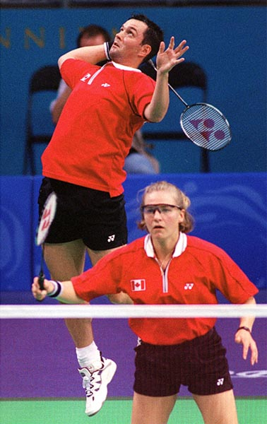 Canada's Milaine Cloutier and Bryan Moody play a set of mixed doubles badminton at the 2000 Sydney Olympic Games. (CP Photo/ COA)