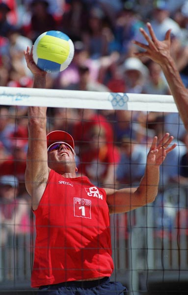 Canada's John Child  in action during a beach volleyball tournament  at the Sydney 2000 Olympic Games. (CP PHOTO/ COA)