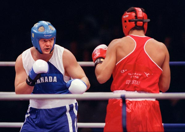 Canada's Artur Binkowski spars with his opponent in the ring at the 2000 Sydney Olympic Games. (CP Photo/ COA)
