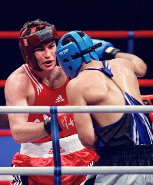 Canada's Mike Strange battles his opponent in the ring at the 2000 Sydney Olympic Games. (CP Photo/ COA)