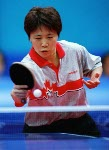 Canada's Johnny Huang of Toronto hits a shot during his loss to Aleksandar Karakasevic of Serbia and Montenegro in men's table tennis at the Summer Olympics in Athens, Greece,  Monday, August 16, 2004.  (CP PHOTO/COC/Mike Ridewood)