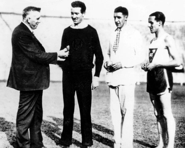 Canada's Francis Amyot (second from left) receives a gold medal in the 1,000m canoeing event at the 1936 Berlin Olympics. (CP Photo/COA)