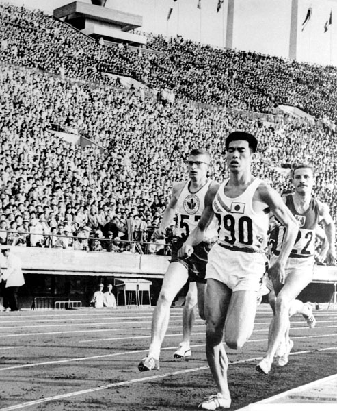 Canada's Bill Crothers (left) competes in an athletics event at the 1964 Tokyo Olympics. (CP Photo/COA)