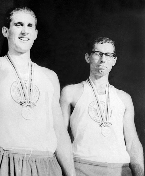 Canada's Roger Jackson and George Hungerford celebrate their gold medal win in the rowing event at the 1964 Tokyo Olympics. (CP Photo/COA)