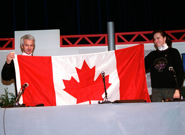 Canada's Sylvie Daigle and Walter Sieber hold up the Canadian flag at the 1992 Albertville Olympic winter Games. (CP PHOTO/COA/Ted Grant)