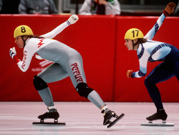 Canada's Nathalie Lambert (left) competes in the short track speed skating event at the 1992 Albertville Olympic winter Games. (CP PHOTO/COA/Ted Grant)