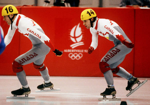 Canada's Mark Lackie (left) and Michel Daigneault competing in the short track speed skating event at the 1992 Albertville Olympic winter Games. (CP PHOTO/COA/Ted Grant)