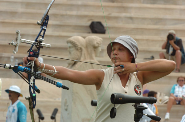 Marie-Pier Beaudet of Canada focuses on her target during the first round of the women's archery individual eliminations competition at the 2004 Olympic Games at the Panathinaiko Stadium in Athens, Sunday August 15, 2004. (CP PHOTO/COC-Andre Forget)