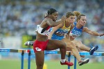 Canada's Perdita Felicien of Pickering, Ont. was second in her heat of women's 100 metre hurdles in track and field action at the Athens Olympics, Sunday, August 22, 2004.(CP PHOTO/COC-Mike Ridewood)