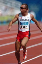 Canadian sprinter Nicolas Macrozonaris of Laval, Quebec, crossed the line with a time of 10.40 to move on during the 100m heat at the Summer Olympic Games in Athens on Saturday, August 21, 2004. (CP PHOTO/COCAndre Forget)