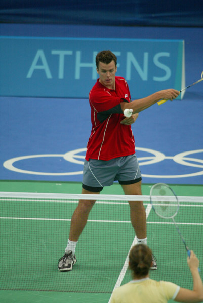 Philippe Bourret of Montreal, Quebec, hits the birdie during a badminton training for the summer Olympic Games in Athens, Greece, Tuesday, August 10, 2004. (CP PHOTO/COC-Mike Ridewood)