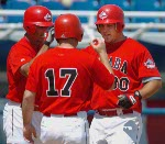Canadian Pete Laforest is congratulated by third base coach Tim Leiper after hitting a three-run homer against Italy during men's baseball action at the 2004 Summer Olympic Games in Athens, Greece, Monday, August 16, 2004. (CP PHOTO/COC/Andre Forget)