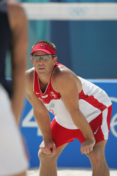 Mark Heese of Toronto in Canada's loss in beach volleyball at the Athens Olympics, Saturday, August 14, 2004. (CP PHOTO/COC-Mike Ridewood)
