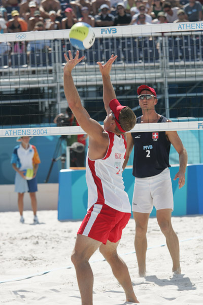 Mark Heese of Toronto goes up for the ball against Patrick Heuscher of Switzerland in Canada's loss in beach volleyball at the Athens Olympics, Saturday, August 14, 2004. (CP PHOTO/COC-Mike Ridewood)