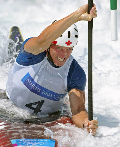 Canada's David Ford of Edmonton rounds a gate in kayak final action at the Athens Olympics, Friday, August 20, 2004.  Ford was fourth. (CP PHOTO/COC-Mike Ridewood)