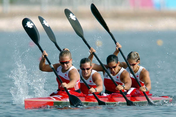 Canada's Karen Furneaux, Carrie Lightbound, Kamini Jain and Jillian D'Alession paddle during the K4 500m final during the Athens 2004 Summer Olympic Games on Friday, August 27, 2004. The womens K4 team came in eighth. (CP PHOTO/COC-Andre Forget)
