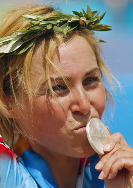 Canada's Marie-Helene Premont of Chateau-Richer, Que. kisses her silver medal in women's mountain bike action at the Athens Olympics, Friday, August 27, 2004.(CP PHOTO/COC-Mike Ridewood)