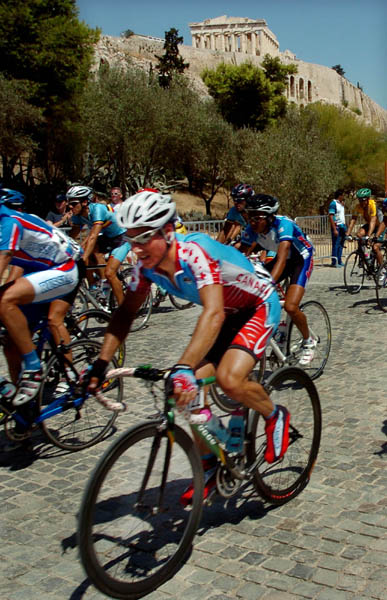 Eric Wohlberg of Canada races past the Acropolis during the road race of the Athens 2004 Summer Olympic Games Saturday August 14, 2004. (CP PHOTO/COC-Andre Forget)