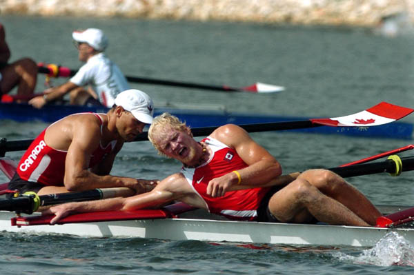 Canada's mens eight (left to right)  Andrew Hoskins and Joe Stankevicius react after placing fifth during the mens eight final during the Athens 2004 Summer Olympic Games Sunday, August 22, 2004. (CP PHOTO/COC-Andre Forget)