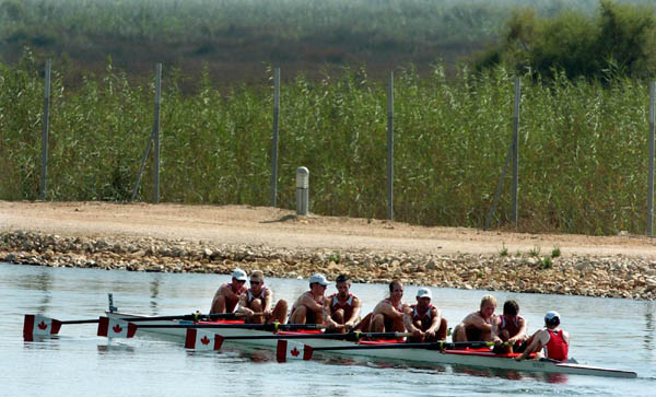 Canada's Mens Eight row away from the bassin after placing 5th in the final during the Athens 2004 Summer Olympic Games Sunday, August 22, 2004. (CP PHOTO/COC-Andre Forget)